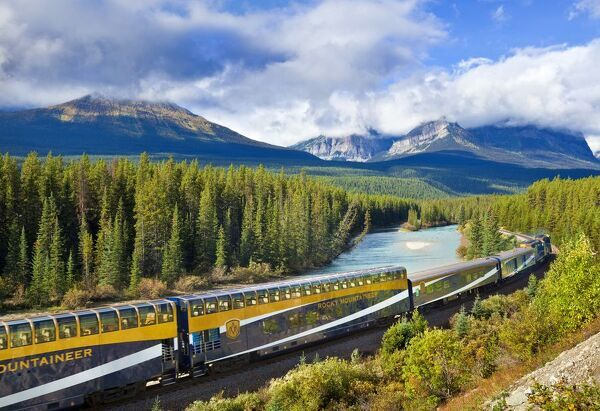 Rocky Mountaineer train at Morant's curve near Lake Louise in the Canadian Rockies. © Neale Clark