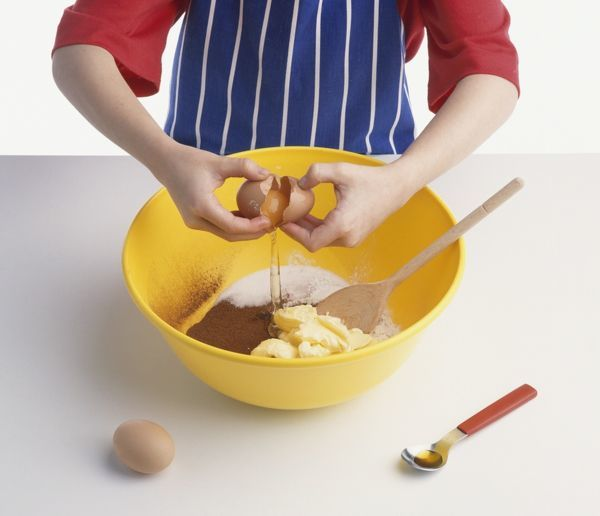 Adding ingredients for a chocolate sponge cake in a mixing for Chocolate sponge ingredients