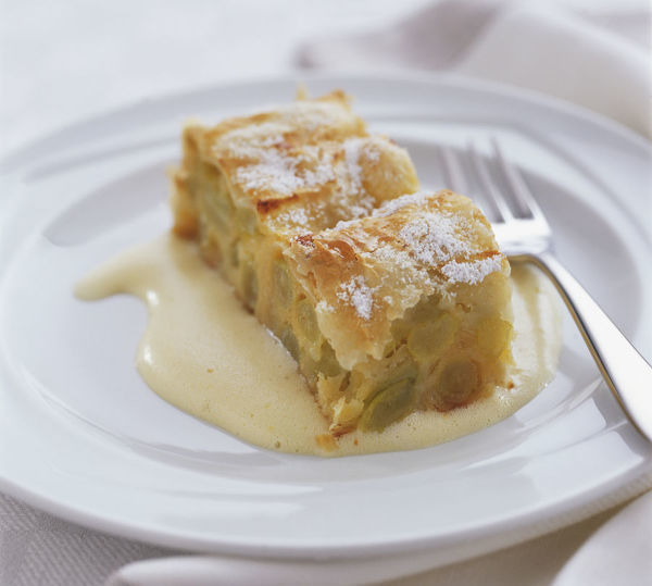 Piece of Strudel cake made with fresh grapes, served with ...