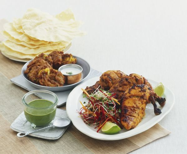 Tandoori chicken, cucumber dip (Raita) and deep-fried ...