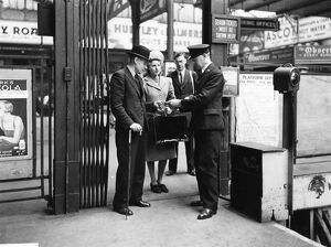 Passengers' tickets being checked at Paddington, about 1940