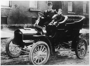 Henry Ford and son Edsel in a 1905 Ford Model F