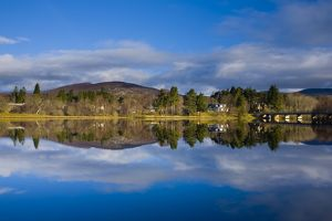 Scotland, Scottish Highlands, Cairngorms National Park. Mirror like reflections upon Loch Insh near Kincraig.