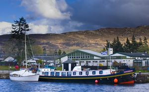 Scotland, Scottish Highlands, Fort Augustus. Tourist sight seeing barge moored on the Caledonian Canal in