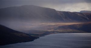 Scotland, Scottish Highlands, Little Loch Broom. Rain clears revealing the mountain peaks surrounding Little