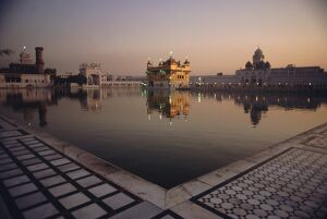 Dawn at the Golden Temple and cloisters and the Holy Pool of Nectar