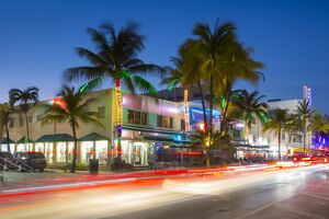 Ocean Drive restaurants and Art Deco architecture at dusk, South Beach, Miami Beach