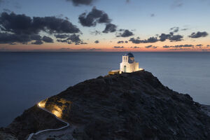 White Greek Orthodox chapel of Eftamartyres on headland at dawn, Kastro, Sifnos, Cyclades