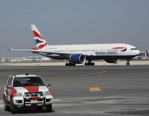 Boeing 777-200 British Airways at Dubai airport with ramp vehicle