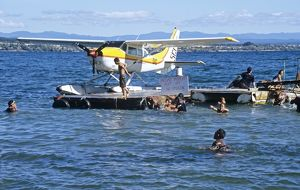 Cessna seaplane on pontoon on Lake Taupo, New Zealand