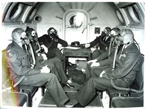 Crew and officers wear oxygen masks during a flight on a Vickers Valiant
