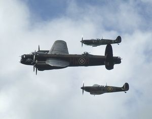 2011 Goodwood Revival Lancaster bomber and 2 Spitfires in aerial display.