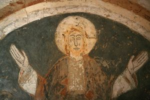 12th century Romanesque fresco depicting Jesus Christ in Saint Chef abbey church