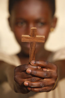 Young African christian holding a cross