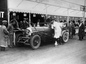 Le Mans 1927 Old Number 7 3 litre Bentley at the pits being refilled by Dr J D Benjafield